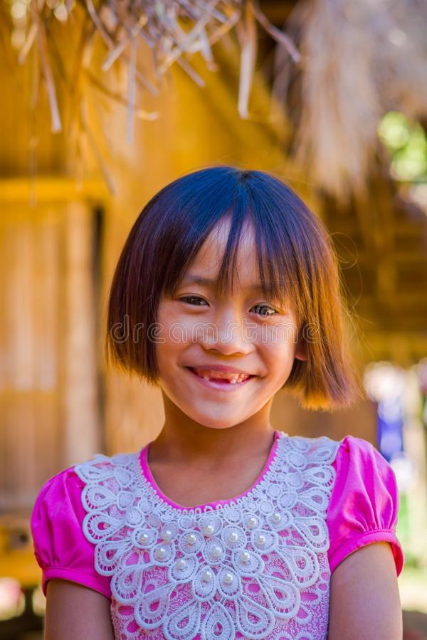 CHIANG RAI, THAILAND - FEBRUARY 01, 2018: Close up of unidentified smiling little girl belongs to a Karen Long Neck hill stock image