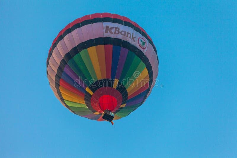 Hot air balloon flying in the sky at sunrise. Chiang Rai,Thailand - February 18,2018:hot air balloon flying above Singha park in Chiangrai Thailand. balloons stock photos