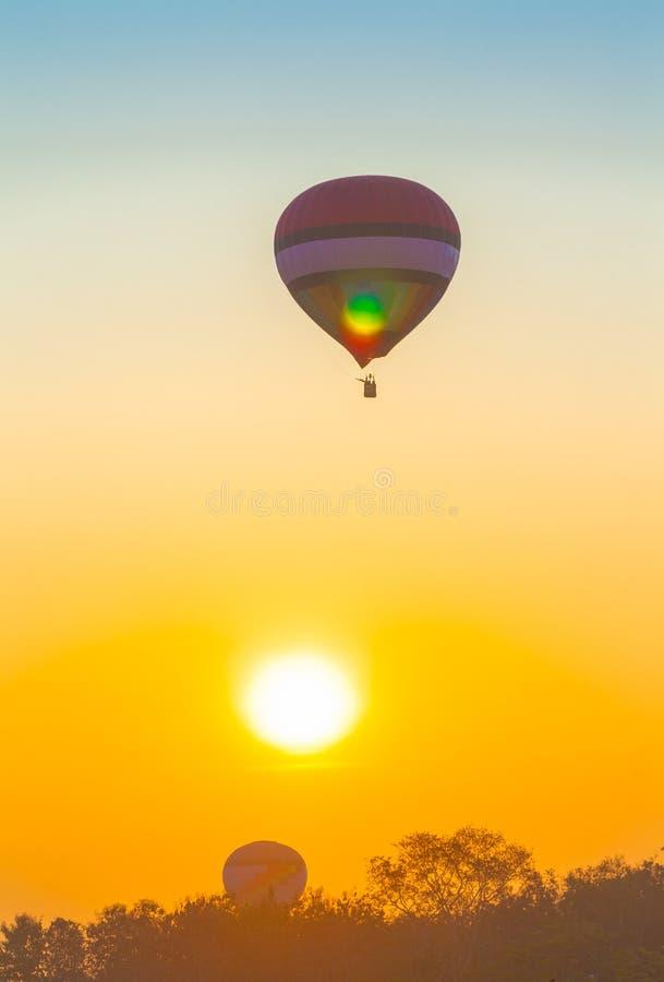 Hot air balloon flying in the sky at sunrise. Chiang Rai,Thailand - February 18,2018:hot air balloon flying above Singha park in Chiangrai Thailand. balloons stock photo