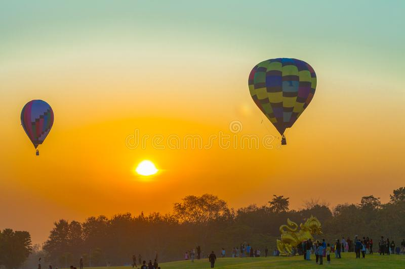 Hot air balloons flying in the sky at sunrise. Chiang Rai,Thailand - February 18,2018:hot air balloon flying above Singha park in Chiangrai Thailand. balloons stock photography