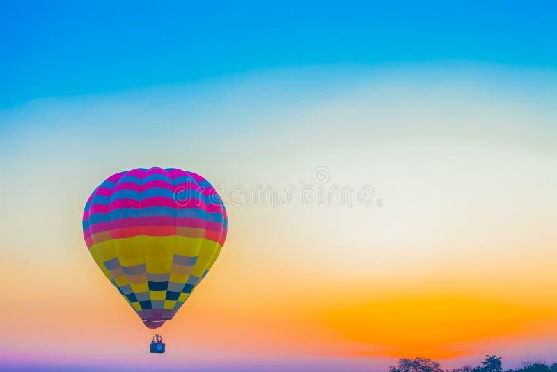 Hot air balloon flying in the sky at sunrise. Chiang Rai,Thailand - February 18,2018:hot air balloon flying above Singha park in Chiangrai Thailand. balloons royalty free stock image