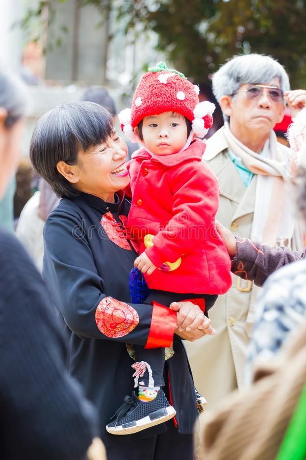 CHIANG RAI, THAILAND - JANUARY 13 : Unidentified asian mother holding her daughter in arms on January 13, 2018 in Chiang rai, royalty free stock images