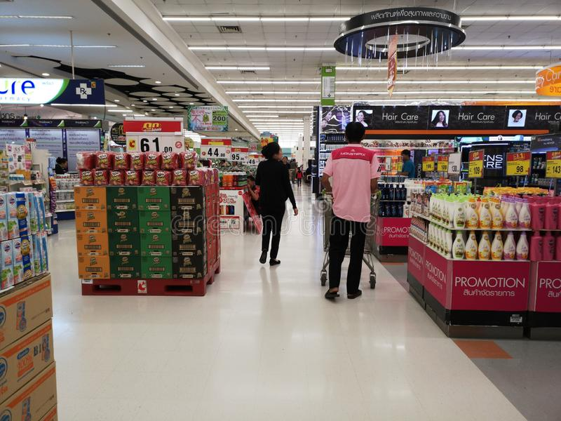 CHIANG RAI, THAILAND - MARCH 4 : Unidentified asian customers looking for goods on shelf in supermarket on March 4, 2019 in Chiang royalty free stock photography