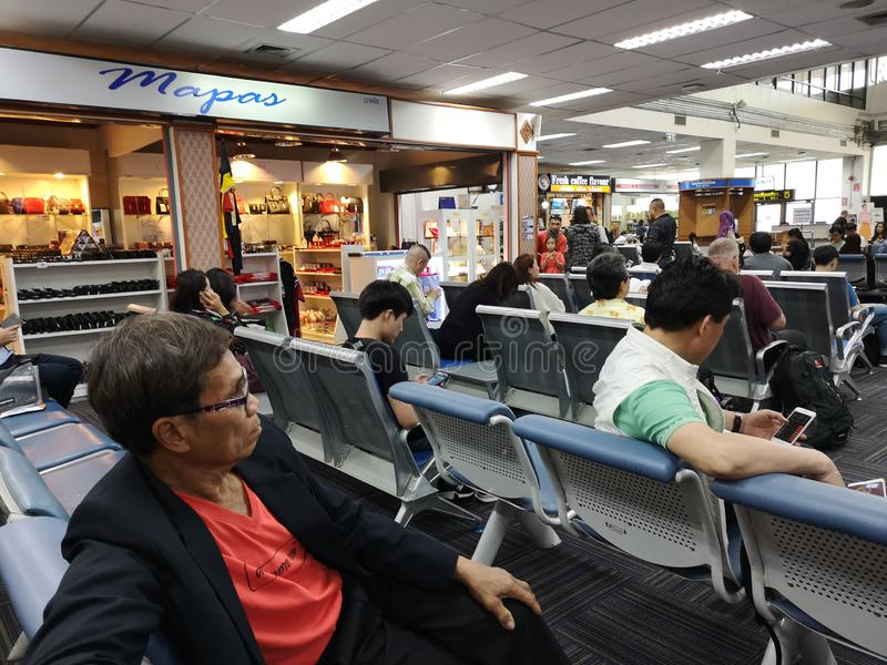CHIANG RAI, THAILAND - MARCH 29 : unidentified travelers waiting for their flight at airport on March 29, 2019 in Chiang rai, royalty free stock image