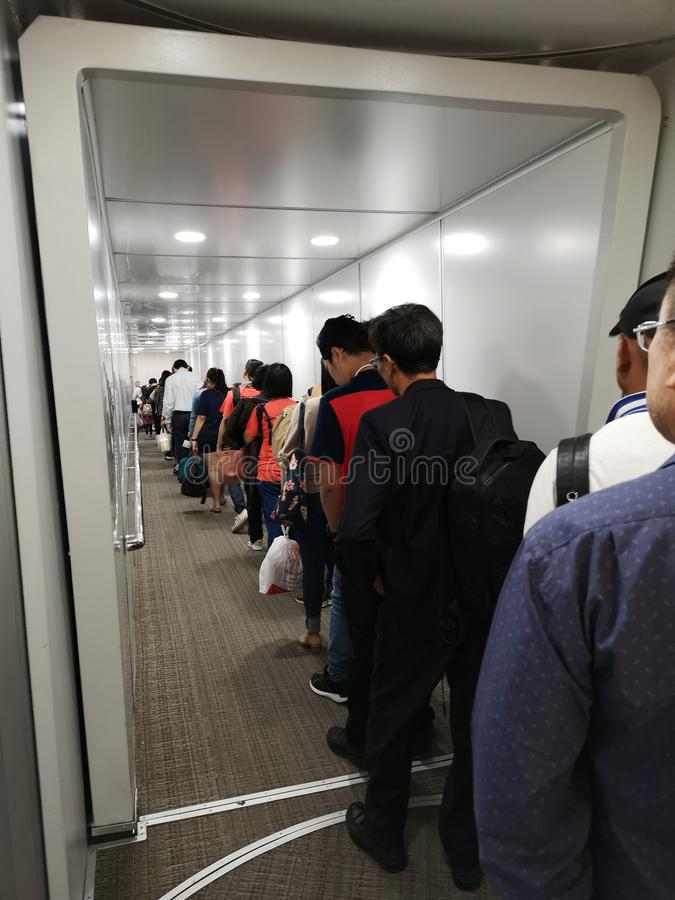 CHIANG RAI, THAILAND - MARCH 29 : unidentified travelers walking inside aero bridge or jetway at airport on March 29, 2019 in stock image