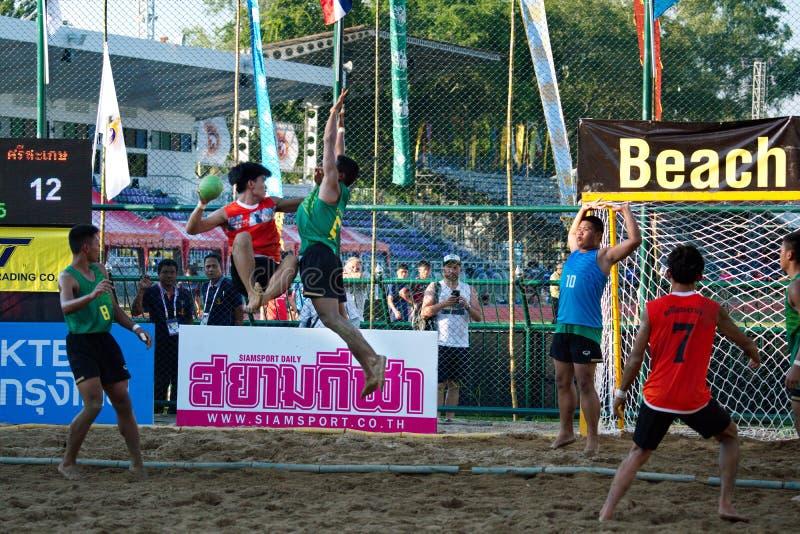 Beach Handball, player making a service at The 2018 Thailand National Games, Jiang Hai Games. Chiang Rai, Thailand - November 19, 2018 : Beach Handball player royalty free stock photo