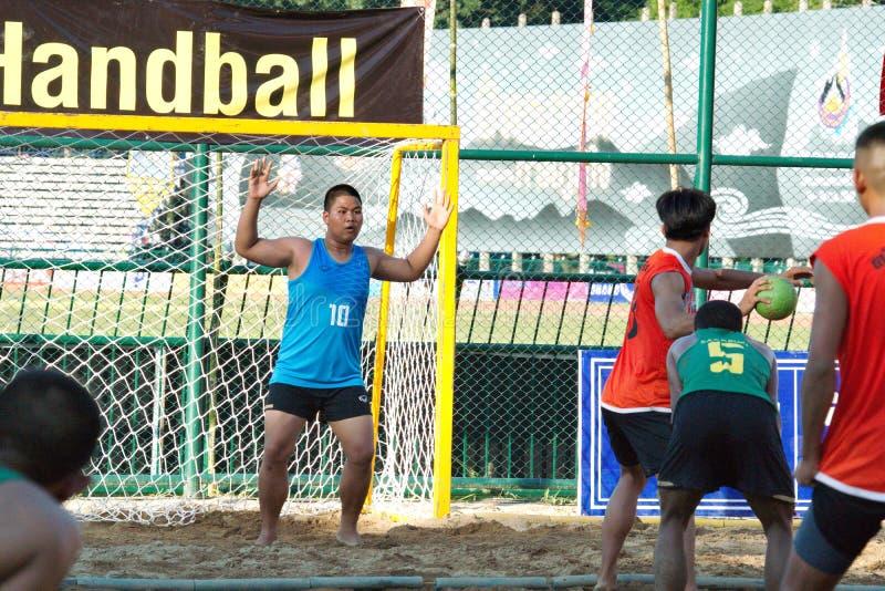 Beach Handball, player making a service at The 2018 Thailand National Games, Jiang Hai Games. Chiang Rai, Thailand - November 19, 2018 : Beach Handball player stock photo