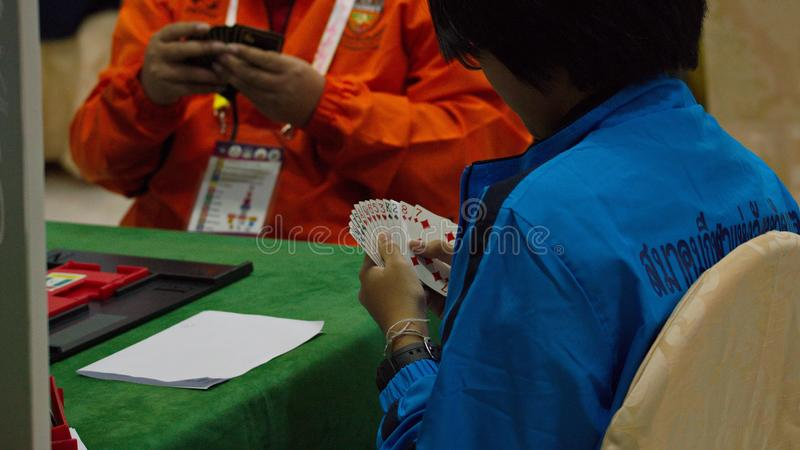 Bridge card game, during the Thailand National Games, Chiang Rai Games. Chiang Rai, Thailand - November 19, 2018 : Bridge, a four-player partnership trick stock photo