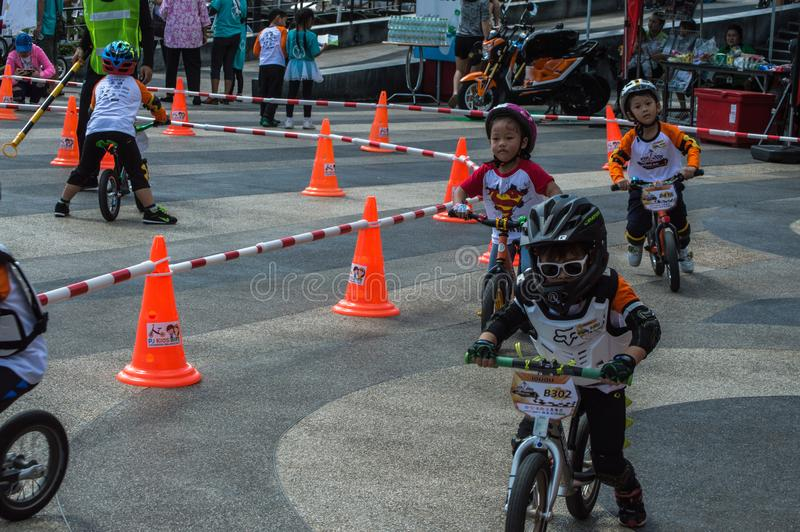 Flipper Balance Bike Chiangrai Championship, Children participate in balance bicycle race. Chiang Rai, Thailand - November 12, 2017 : Flipper Balance Bike royalty free stock photo