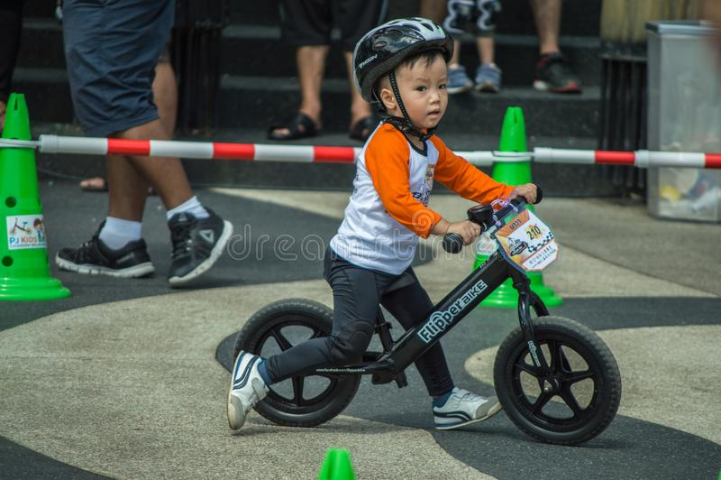 Flipper Balance Bike Chiangrai Championship, Children participate in balance bicycle race. Chiang Rai, Thailand - November 12, 2017 : Flipper Balance Bike royalty free stock images