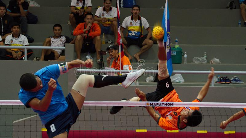 Sepak takraw two player team, player making a service at The 2018 Thailand National Games, Chiang Rai Games. Chiang Rai, Thailand - November 19, 2018 : Sepak stock photos