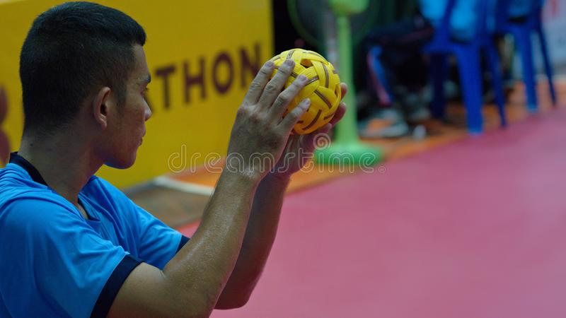 Sepak takraw two player team, player making a service at The 2018 Thailand National Games, Chiang Rai Games. Chiang Rai, Thailand - November 19, 2018 : Sepak royalty free stock images