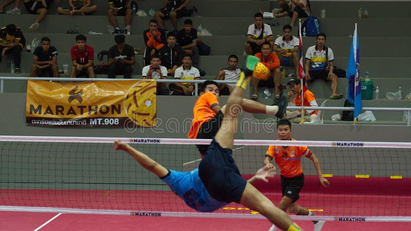 Sepak takraw two player team, player making a service at The 2018 Thailand National Games, Chiang Rai Games. Chiang Rai, Thailand - November 19, 2018 : Sepak royalty free stock photos
