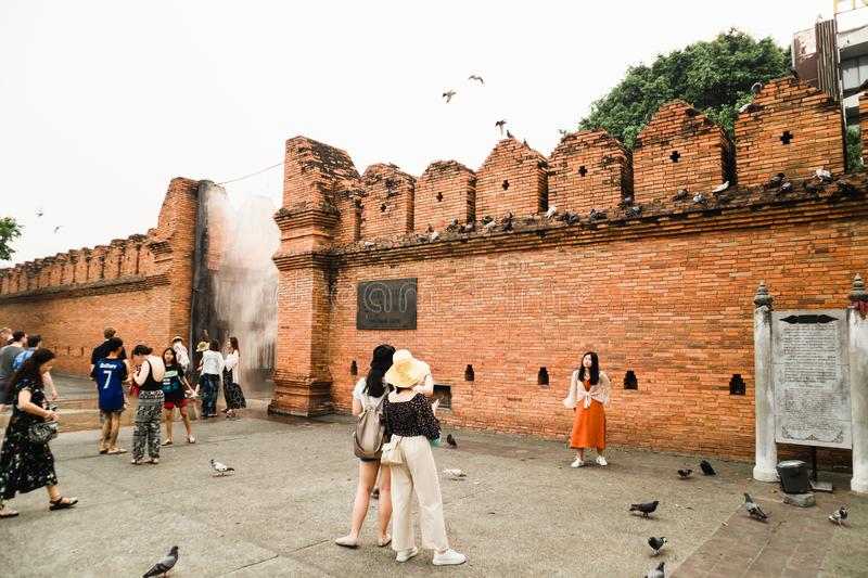 CHIANGMAI,THAILAND APRIL 9,2019 - Group of Tourist at Thapae gate ancient brick wall of Chiangmai royalty free stock photo