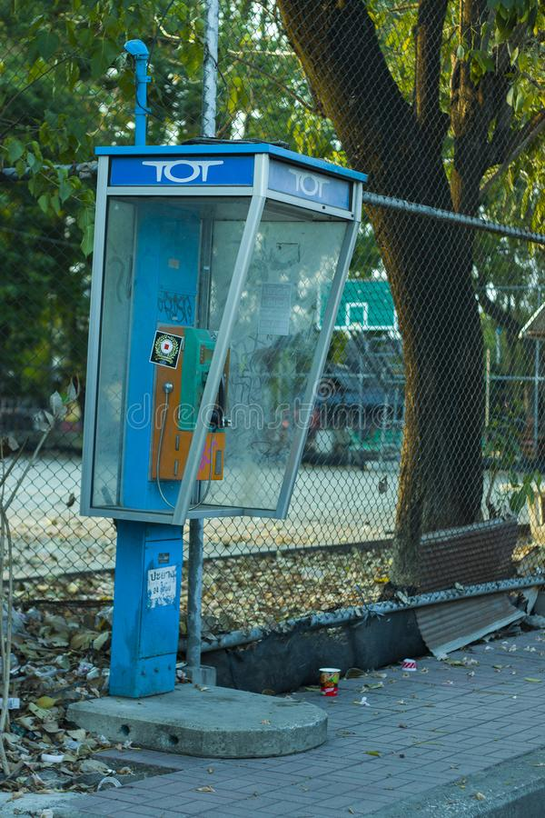 CHIANGMAI,THAILAND-APRIL 30,2019 : Old Public telephones at side walk but no customers use the service because people tend to use stock photos