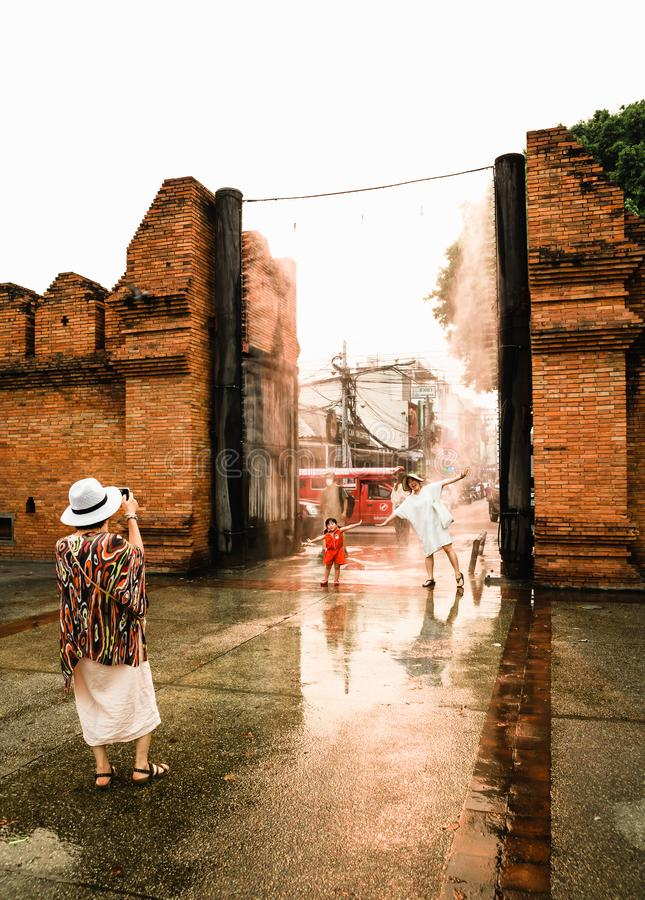 CHIANGMAI,THAILAND APRIL 9,2019 - Tourist family taking a photo at Thapae gate ancient brick wall of Chiangmai after the rain stock image