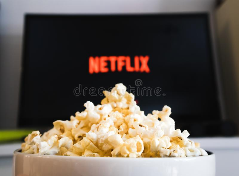 CHIANGMAI, THAILAND - JULY 5, 2019- Popcorn bowl and Netflix logo on Smart TV royalty free stock image