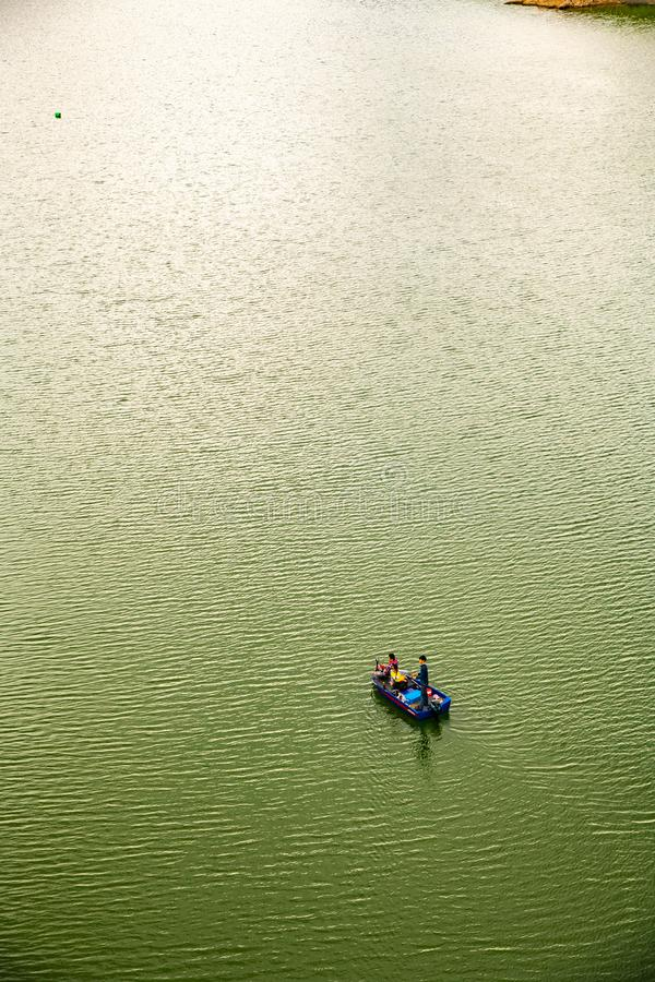 Small boat in Mae Kuang Udom Thara dam. CHIANGMAI, THAILAND - July 7, 2019  : Small boat in Mae Kuang Udom Thara dam, Thailand stock photo