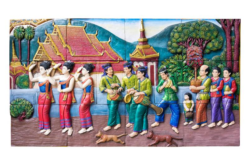 CHIANGMAI ,THAILAND - SEPTEMBER 9, 2016 : Stone carving of traditional Thai rural culture life in the past on temple wall at Wat stock image