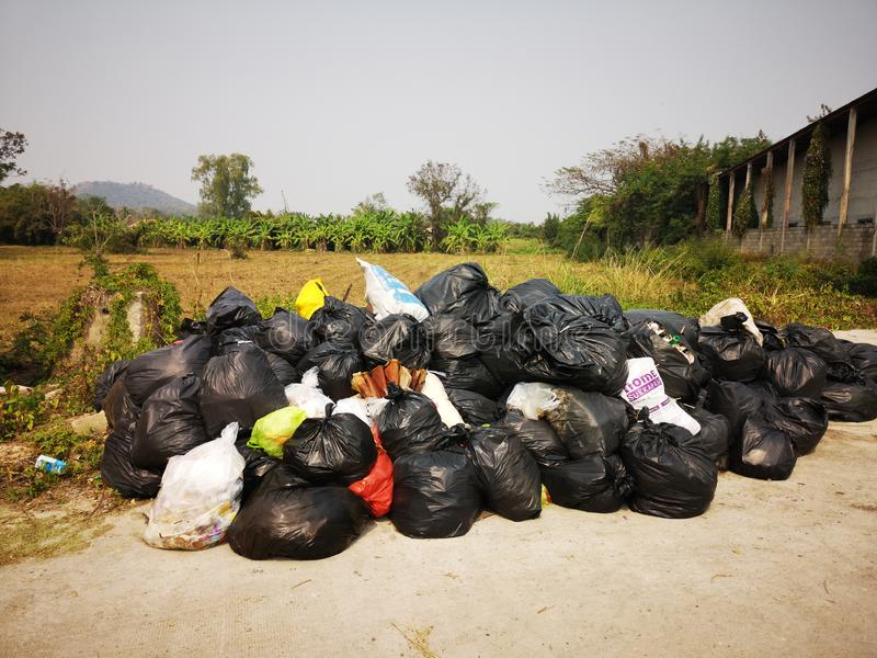 CHIANGRAI, THAILAND - FEBRUARY 12: Pile of black garbage on the footpath at side road on February 12, 2019 in Chiangrai, Thailand stock images