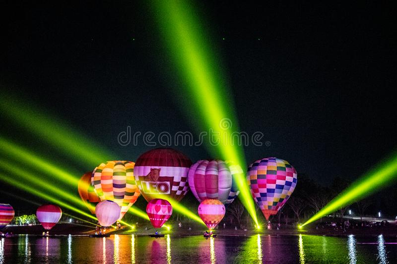 CHIANGRAI , THAILAND - February 15, 2019 : Vivid hot air ballons with the light show in the dark night sky at Singha Park Chiang stock photo
