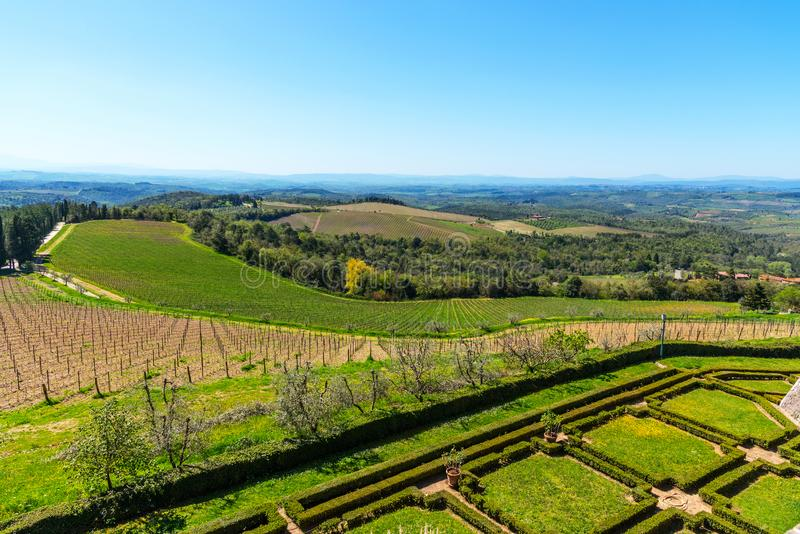 Chianti Region, Italy - April 21, 2018: Farmland rural landscape, cypress trees, vineyards and olive trees from Castello di Brolio royalty free stock image