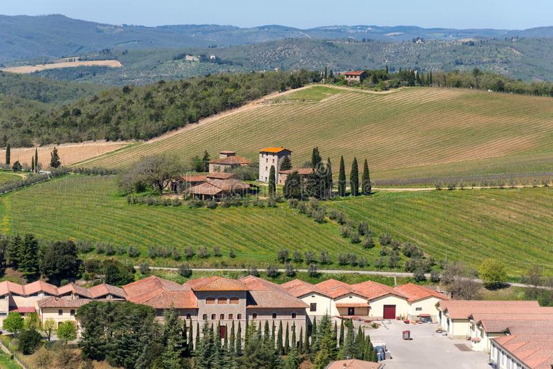 Chianti Region, Italy - April 21, 2018: Farmland rural landscape, cypress trees, vineyards and olive trees from Castello di Brolio royalty free stock images