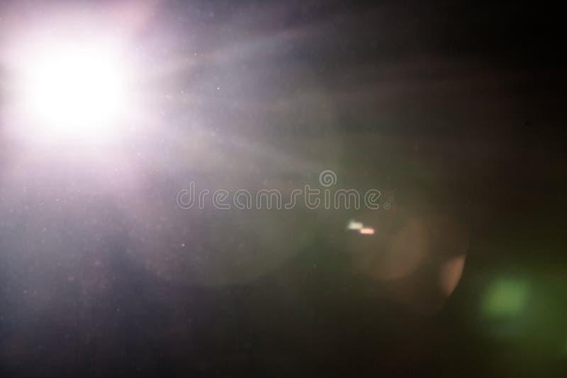 Chiarore e Dusty Atmosphere reali della lente fotografie stock