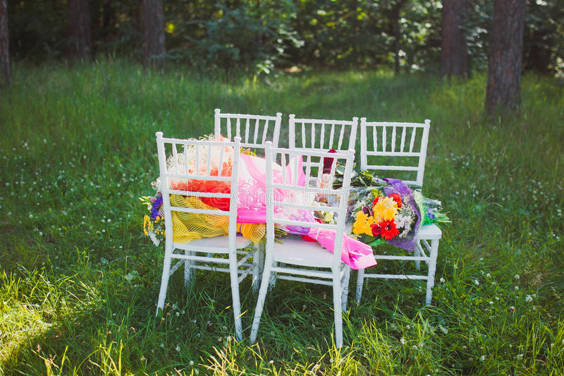 Download Chiavari Chairs On Grass With Bouquet Flowers Stock Image - Image: 88088187