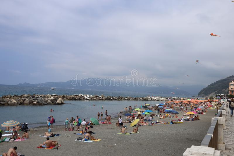 The beach and promenade of Chiavari with bathers stock photos