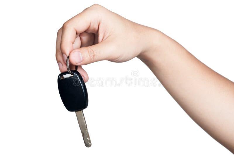 Chiave dell'automobile della tenuta di posizione del segno della mano isolata immagini stock libere da diritti