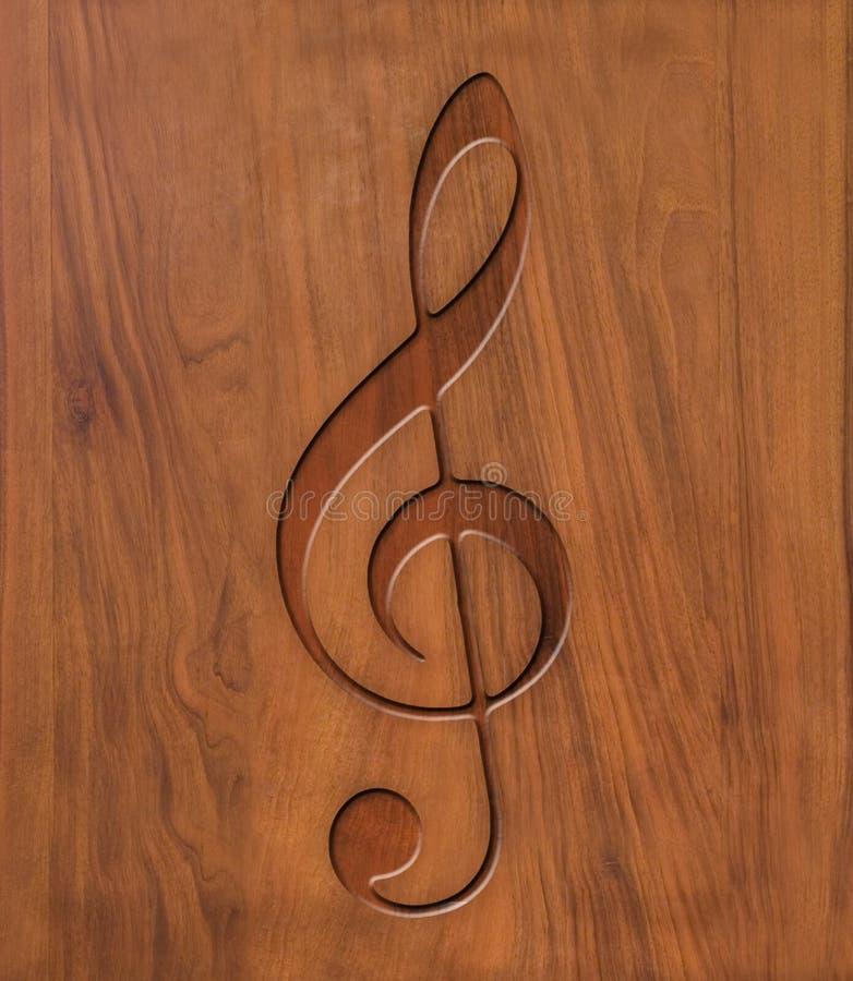 Chiave tripla su legno fotografia stock