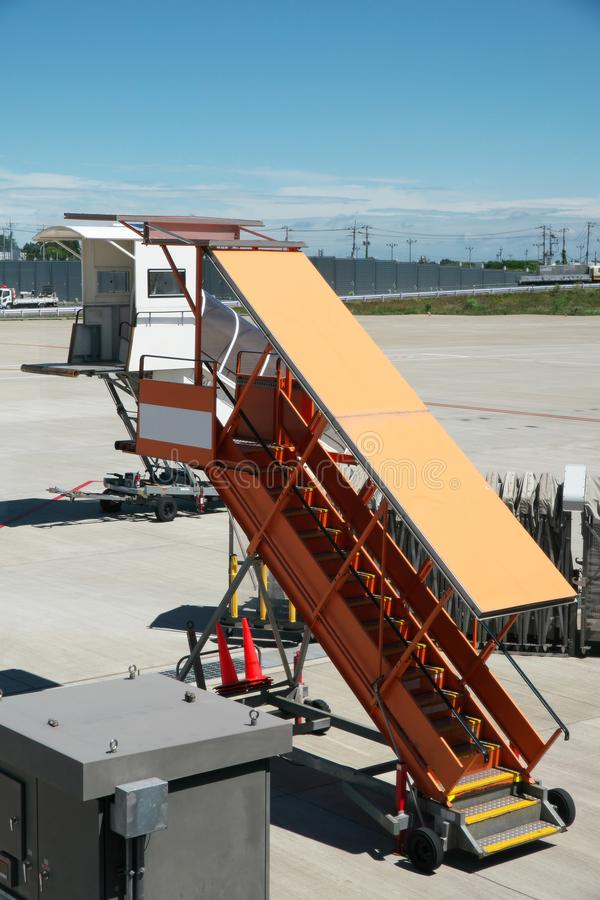 Boarding ramps ready and waiting at an airport royalty free stock photos