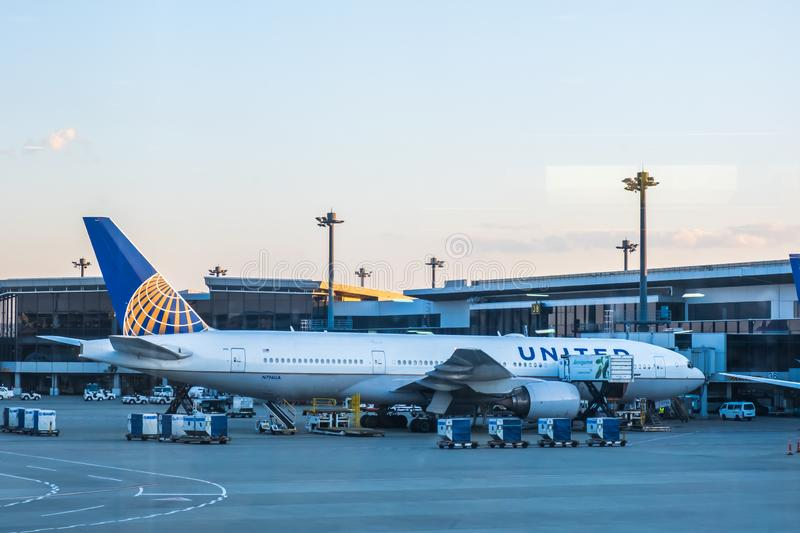 Chiba, Japan - March 24, 2019: View of United Airlines plane, a major American airline headquartered at Willis Tower in Chicago,. Illinois, parking at Narita stock images