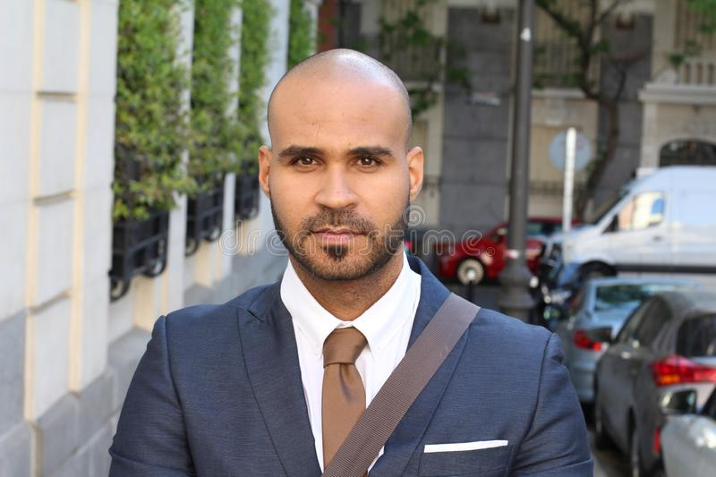 Chic bald businessman looking gorgeous stock photo