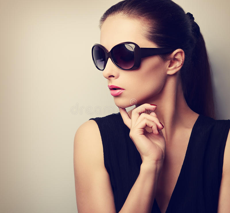 Chic beautiful young female model profile in fashion sunglasses royalty free stock photography