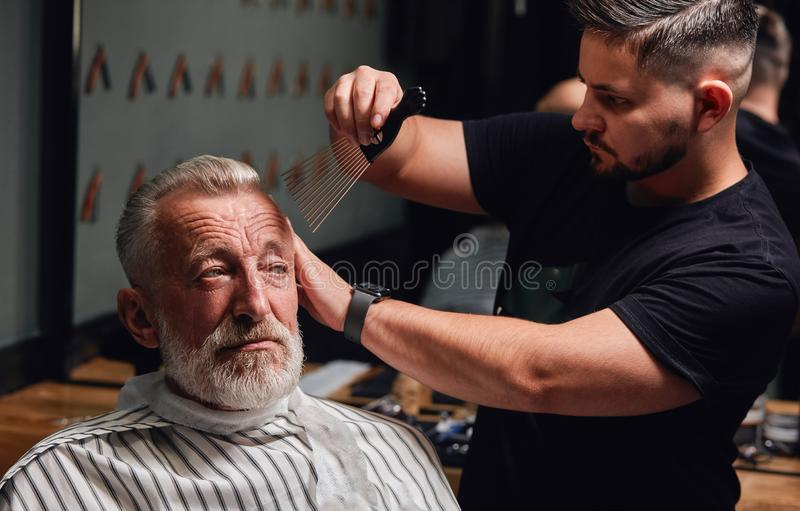 Chic new hairstyle that makes old man look very sophisticated royalty free stock photo