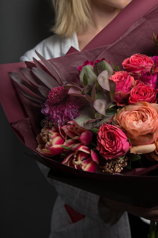 Chic rich bouquet of flowers, luxury decoration, bouquet design, skillful work. Of a florist stock images