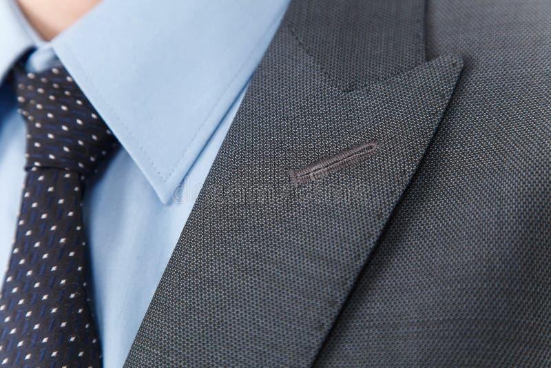 Chic and stylish suit. Business, neckline, classical, elegance. Chic and stylish suit, fashion background / Button suit stripe / Business, neckline stock photo
