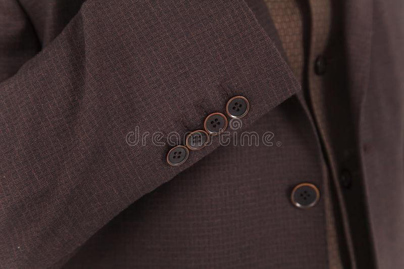 Chic and stylish suit. Business, neckline, classical, elegance. Chic and stylish suit, fashion background / Button suit stripe / Business, neckline royalty free stock photo