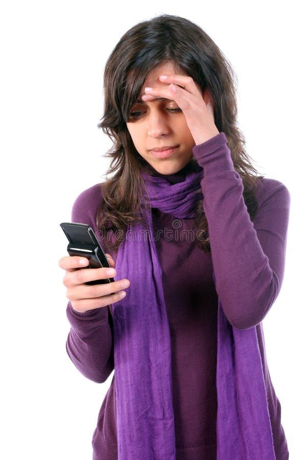 Chica joven cansada y con dolor de cabeza foto de archivo libre de regalías