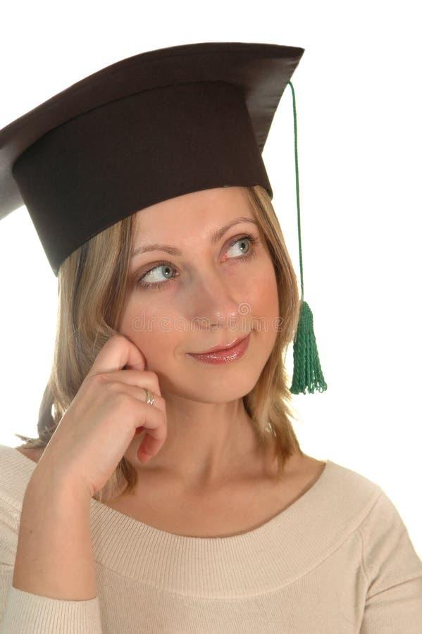 Chica joven con el casquillo del soltero imagenes de archivo
