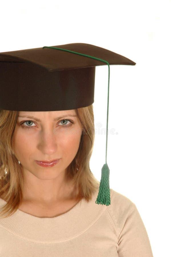 Chica joven con el casquillo del soltero foto de archivo libre de regalías