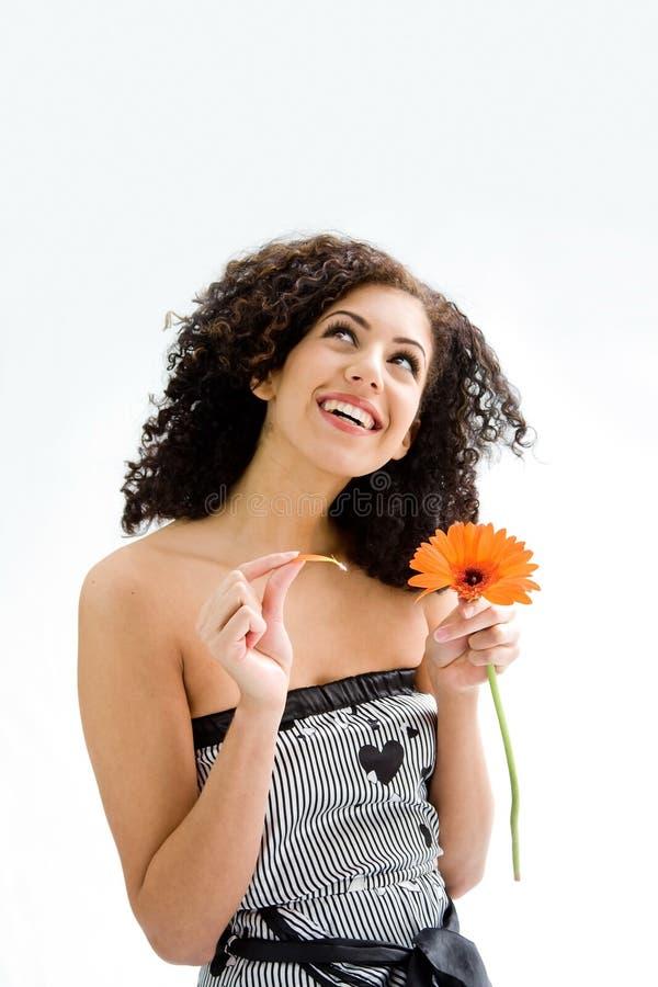 Chica joven con la flor fotografía de archivo