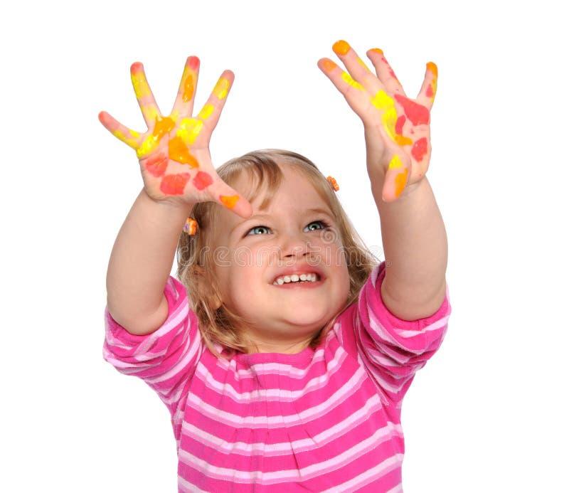 Chica joven con la pintura en las manos imágenes de archivo libres de regalías