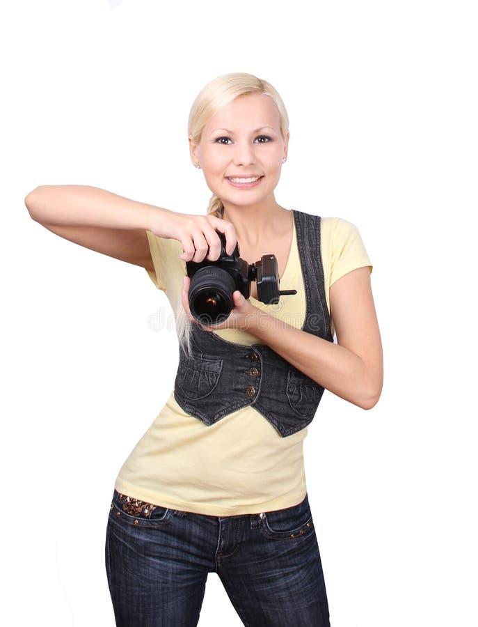 Chica joven con la sonrisa de la cámara aislada en blanco imagen de archivo libre de regalías