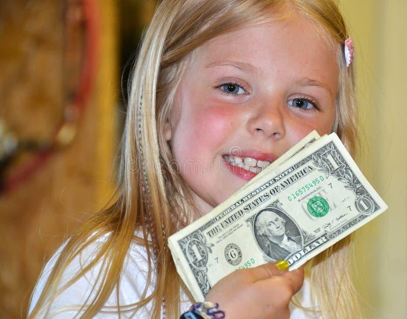 Chica joven con los dólares americanos imagenes de archivo