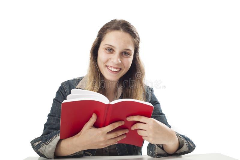 Chica joven del estudiante con el libro fotografía de archivo libre de regalías