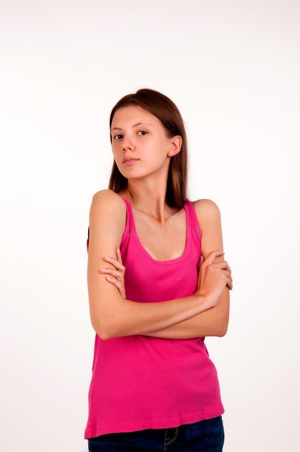 Chica joven descontenta en un top sin mangas rosado fotografía de archivo libre de regalías