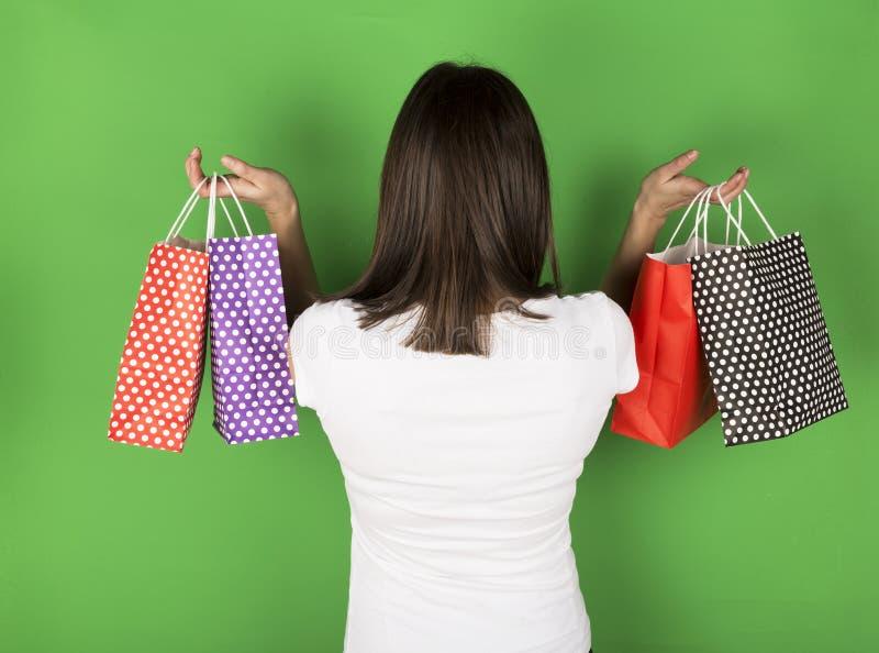 Chica joven después de hacer compras fotografía de archivo libre de regalías